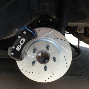 BAD MOVE HERE> Nice looking very squeaky and noisy caliper cover installed.  Eventually removed.