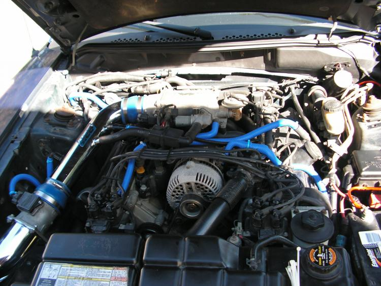 After taking the tower brace off......this reminds me....I need to do a good cleaning job on everything under the hood.