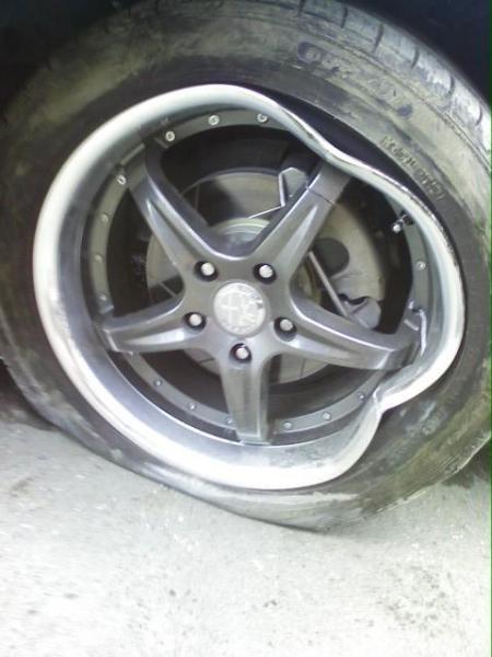 aluminum rim meets curb