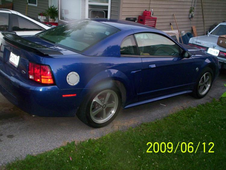 awsome side view ...with mach-1 spoilers, wheels and bullitt shifter knob and gas door