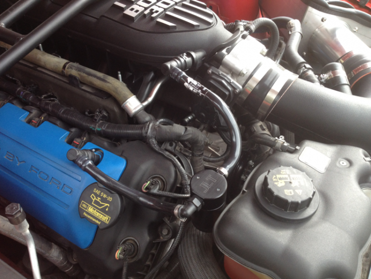 Black powder coated JLT Oil Separator.