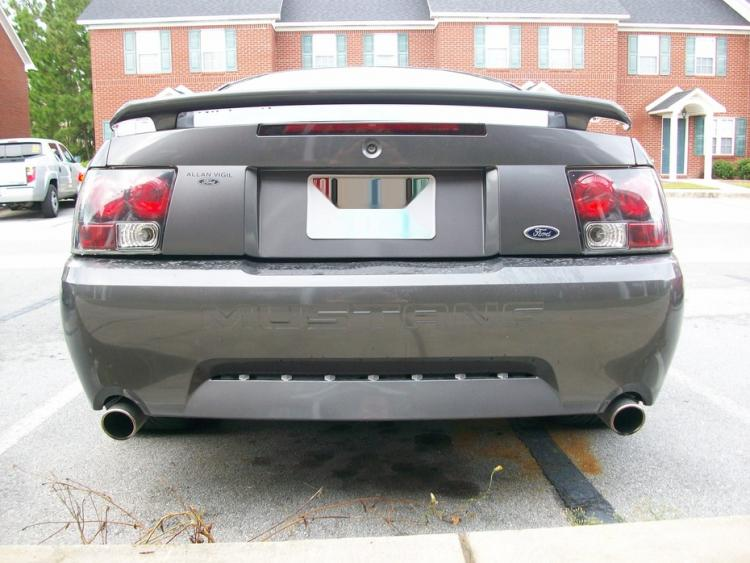 dual exhaust, aftermarket bumper, and tail lights