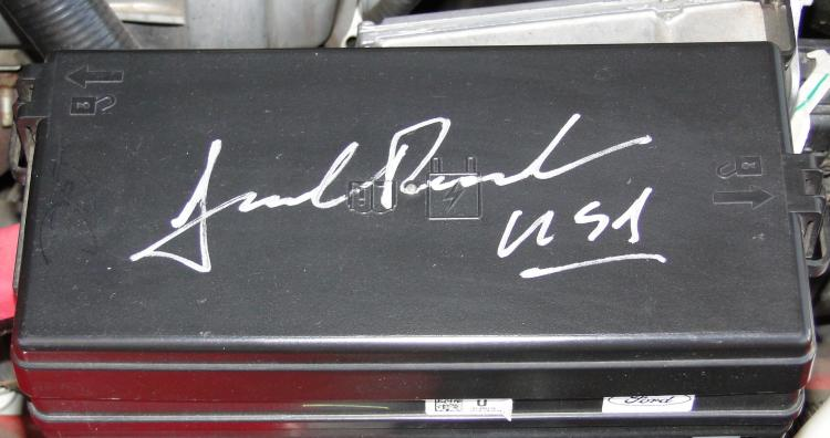 Fuse cover signed by Jack Roush