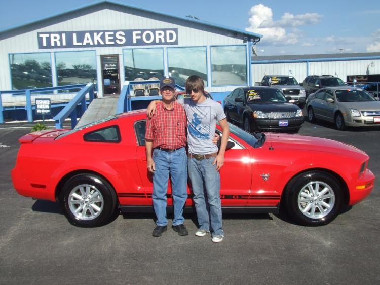 Grandpa and I picking up the Mustang. I had gotten literally zero sleep due to it being the night after graduation...