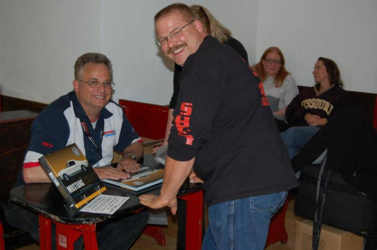 "John Clor from the Ford Performance group joined us in 2010, spoke at the saturday night banquet and was on hand to sign copies of his book ""The Mustang Dynasty""."