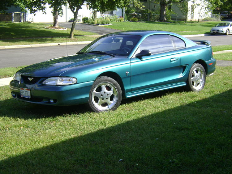 my 1996 v6 stang, bone stock minus the head unit and 94,95 cobra rims