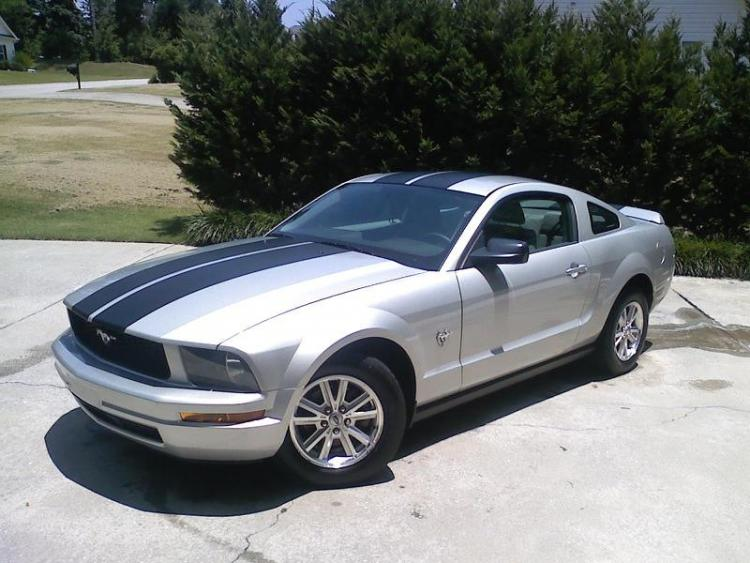 My 2009 V6 Mustang. Still dont have a recent picture with the new quarter window louvers.