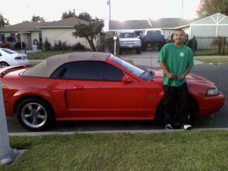 My baby with his mustang lol