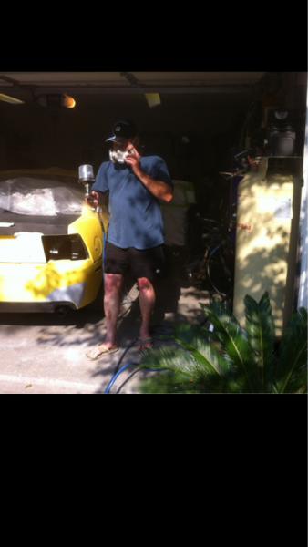 My dad getting ready to spray.