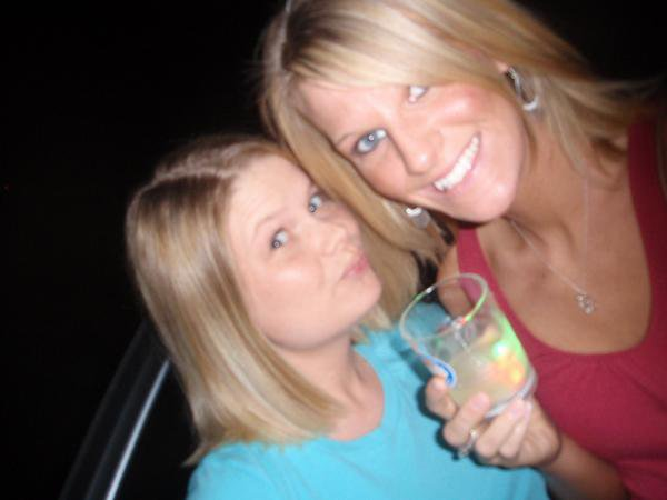 my sister katie & me with my flashy cup (r.i.p.) lol