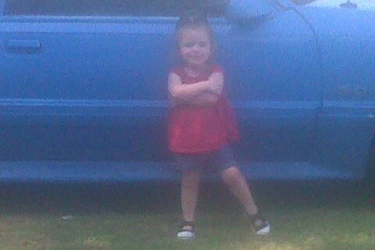 "my youngest posing by ""her"" mustang lol"