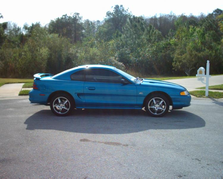 New Years 2002.  This is what she looked like the day I got her.  Jacked up high, cheap knock-off rims and the only mods were shorty headers, flowmasters and a shift kit.