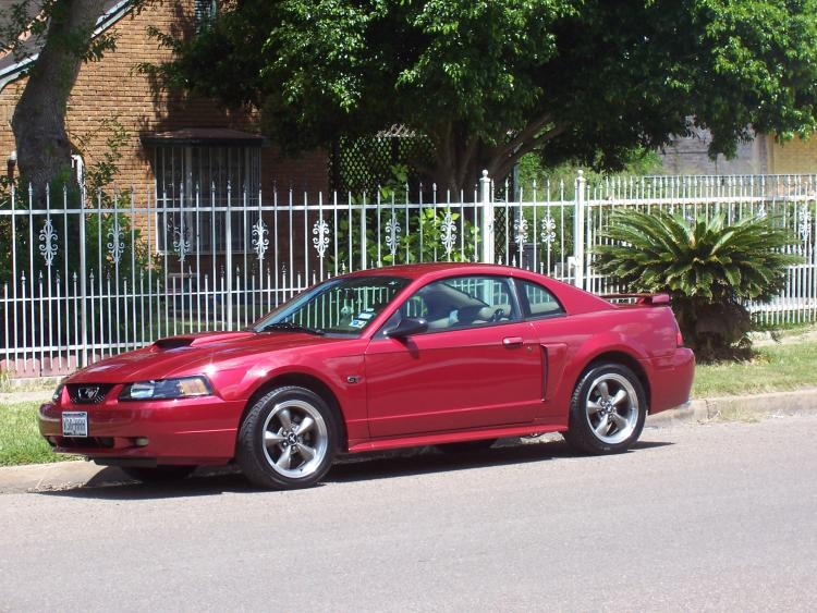 Outside home in TX 2007. Purchased Mustang on 9/06 with 30,867 miles on it.