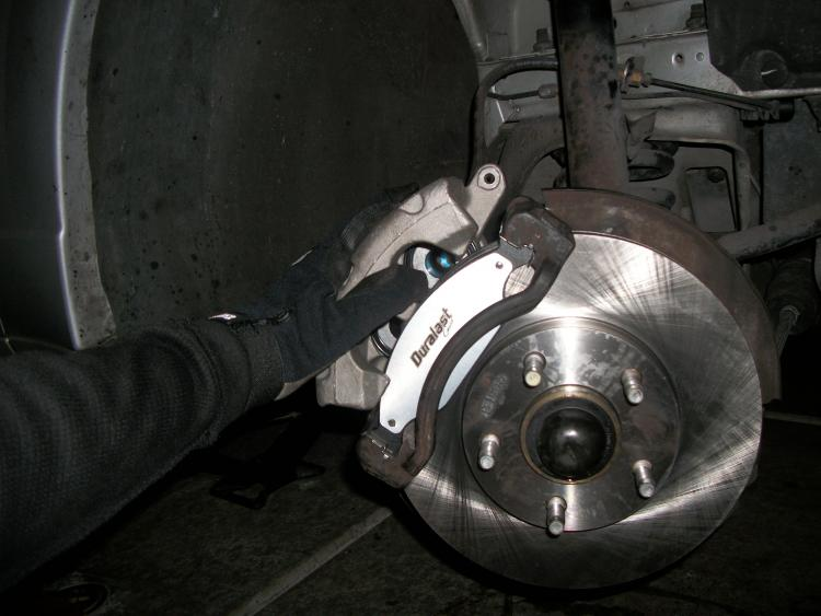 The rotor, caliper, and brake pad job
