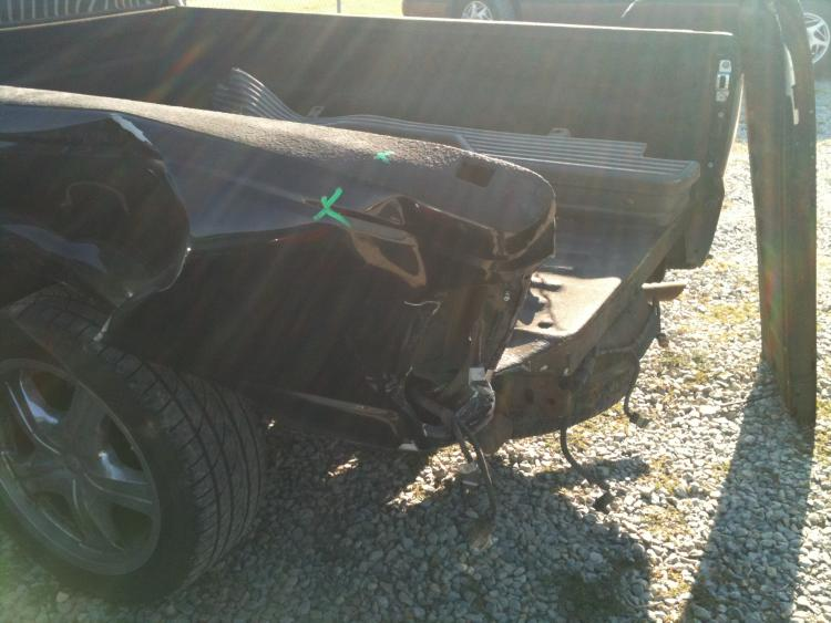 The second wreck which totaled my Ranger.  Aftermath of being hit by a f-ing Chevy.  Bed bent to hell, frame twisted, and bed pushed it to the cab.  RIP to my Mini Truck.
