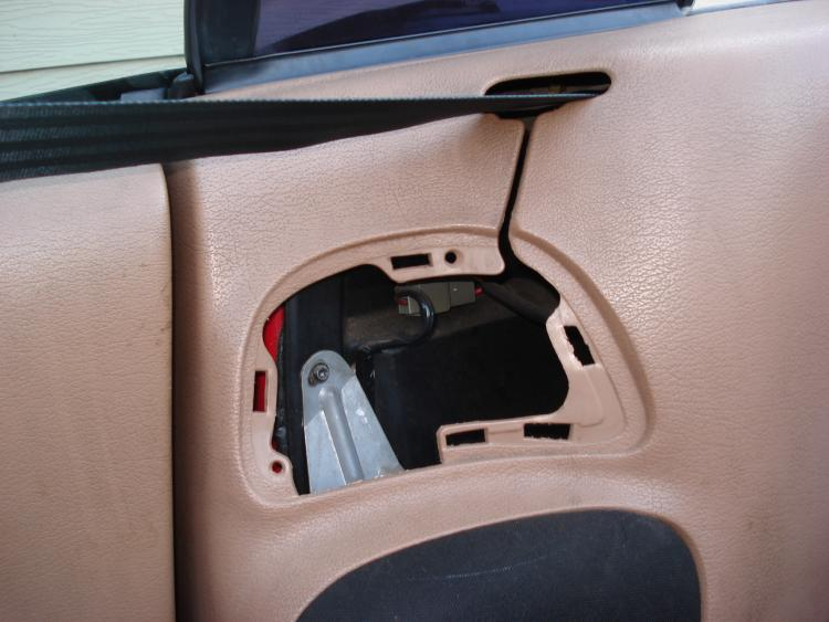 This is a hole in the side panel of the passanger side just below the small window above the speaker.